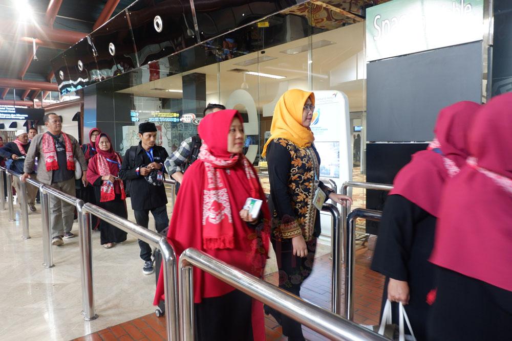 LIGA service handling airport handling travelling tanpa ribet tips travelling dengan anak tips travelling lancar proses check in proses imigrasi bagasi pesawat penjemputan penumpang di bandara